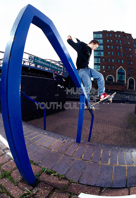 A skateboarder skating on a stairway in London.