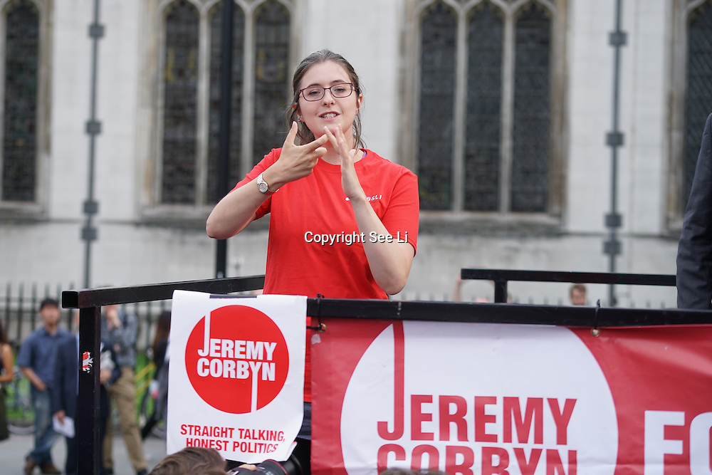 London,England,UK : 27th June 2016 : A ladies showing sign language the crowd KeepCorbyn protest against coup and Build our movement  at Parliament Square, London,UK. photo by See Li