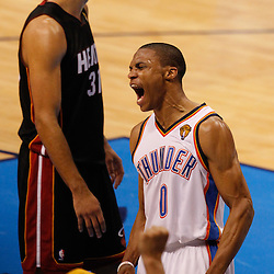 Jun 14, 2012; Oklahoma City, OK, USA;  Oklahoma City Thunder point guard Russell Westbrook (0) reacts during the fourth quarter of game two in the 2012 NBA Finals against the Miami Heat at Chesapeake Energy Arena. Mandatory Credit: Derick E. Hingle-US PRESSWIRE