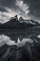Hones of Paine reflect in the calm waters of Lago Nordenerskjold, Torres del Paine National Park, Patagonia, Chile