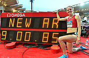Courtney Frerichs (USA) poses with the scoreboard after placing second in the women's steeplechase in an American and North American record 9:00.85 during the Herculis Monaco in an IAAF Diamond League meet at Stade Louis II stadium in Fontvieille, Monaco on Friday, July 20, 2019. (Jiro Mochizuki/Image of Sport)