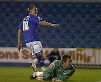 Photo: Matt Bright/Sportsbeat Images.<br /> Millwall v AFC Bournemouth. The FA Cup. 01/12/2007.<br /> Will Hoskins of Millwall scores past Gareth Stewart of Bournemouth