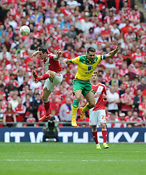 Middlesbrough's Lee Tomlin battles for the high ball with Norwich City's Russell Martin - Photo mandatory by-line: Joe Meredith/JMP - Mobile: 07966 386802 - 25/05/2015 - SPORT - Football - London - Wembley Stadium - Middlesbrough v Norwich - Sky Bet Championship - Play-Off Final