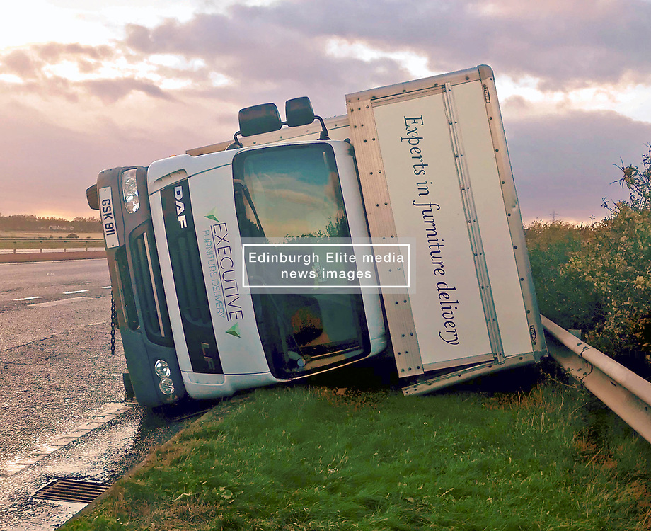 Pictured: <br /> Rescue was on hand the the high-sided delivery lorry on the A1 tonight.  The lorry was blown over on the A1 on the slip road down to join the Edinburgh City Bypass. Police and resuce services will be on high alert as Storm Ali moves across the country.<br /> <br /> <br /> Chris McCluskie  EEm 19 September 2018