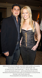 MISS CAROLINE STANBURY and MR CEM HABIB, at a party in London on 30th January 2003.	PGW 102