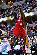 March 14, 2012; Indianapolis, IN, USA; Philadelphia 76ers point guard Jrue Holiday (11) shoots a jumper against the Indiana Pacers at Bankers Life Fieldhouse. Mandatory credit: Michael Hickey-US PRESSWIRE