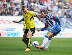 Adam Le Fondre of Wigan Athletic (R) has a shot at goal - Mandatory by-line: Jack Phillips/JMP - 15/10/2016 - FOOTBALL - DW Stadium - Wigan, England - Wigan Athletic v Burton Albion - EFL Championship