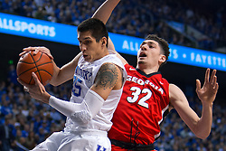 Kentucky forward Derek Willis, left, grabs a rebound from Georgia forward Mike Edwards in the first half.<br /> <br /> The University of Kentucky hosted the University of Georgia, Tuesday, Feb. 09, 2016 at Rupp Arena in Lexington .