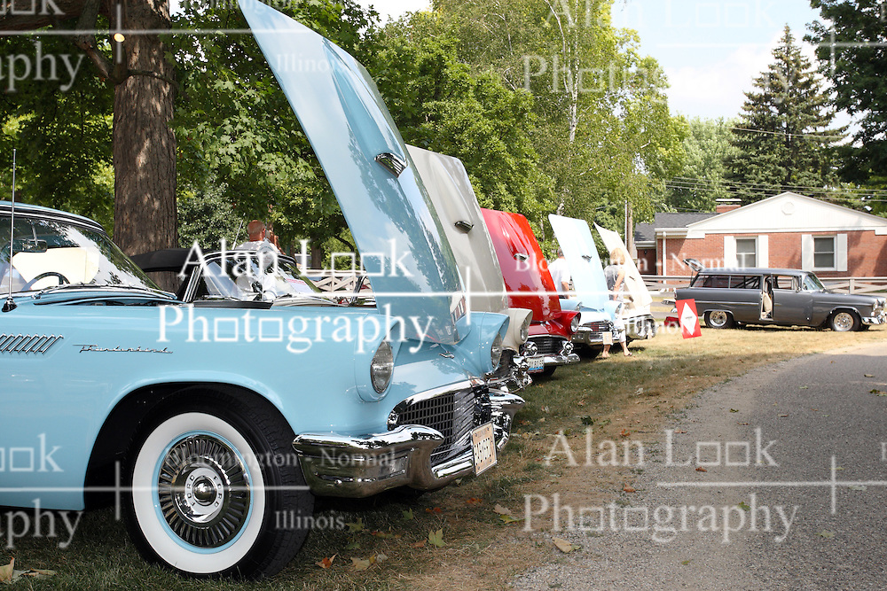 04 August 2012:  Raised hoods on several mid to late 1950's Ford Thunderbirds on display at the McLean County Antique Automobile Club Show at the David Davis Mansion, Bloomington IL