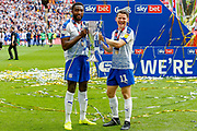 PROMOTED promotion Tranmere Rovers defender Emmanuel Monthe (6) and Tranmere Rovers forward Connor Jennings (11) hold the trophy after the EFL Sky Bet League 2 Play Off Final match between Newport County and Tranmere Rovers at Wembley Stadium, London, England on 25 May 2019.