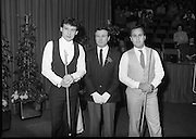 The Benson and Hedges .Irish Masters Snooker..1984..28.03.1984..03.28.1984..28th March 1984..The championship was held at Goffs,Co Kildare. All the top names in snooker took part..Steve Davis,Jimmy White,Eddie Charlton,.Tony Knowles,Dennis Taylor,Tony Meo,.Alex Higgins,Ray Reardon,.Cliff Thorburn,Terry Griffiths,.Bill Werbeniuk and Eugene Hughes..The eventual winner was Steve Davis who beat Terry Griffiths 9 -1 in the final.Picture of the man in charge,Referee Paddy Williams, poses with Jimmy White and Tony Meo before the game begins..