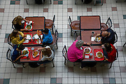 Lunch time for visitors at the Mall of America.  (From the book What I Eat: Around the World in 80 Diets.) The Mall of America is the largest among some 50,000 shopping malls in the United States. In addition to a huge amusement park, it houses over 500 stores, 26 fast-food outlets, 37 specialty food stores, and 19 sit-down restaurants, and employs more than 11,000 year-round employees. In excess of 40 million people visit the mall annually, and more than half a billion have visited since it opened in 1992.