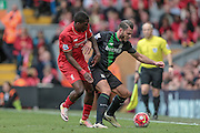 Erik Pieters (Stoke City) and Sheyi Ojo (Liverpool) during the Barclays Premier League match between Liverpool and Stoke City at Anfield, Liverpool, England on 10 April 2016. Photo by Mark P Doherty.