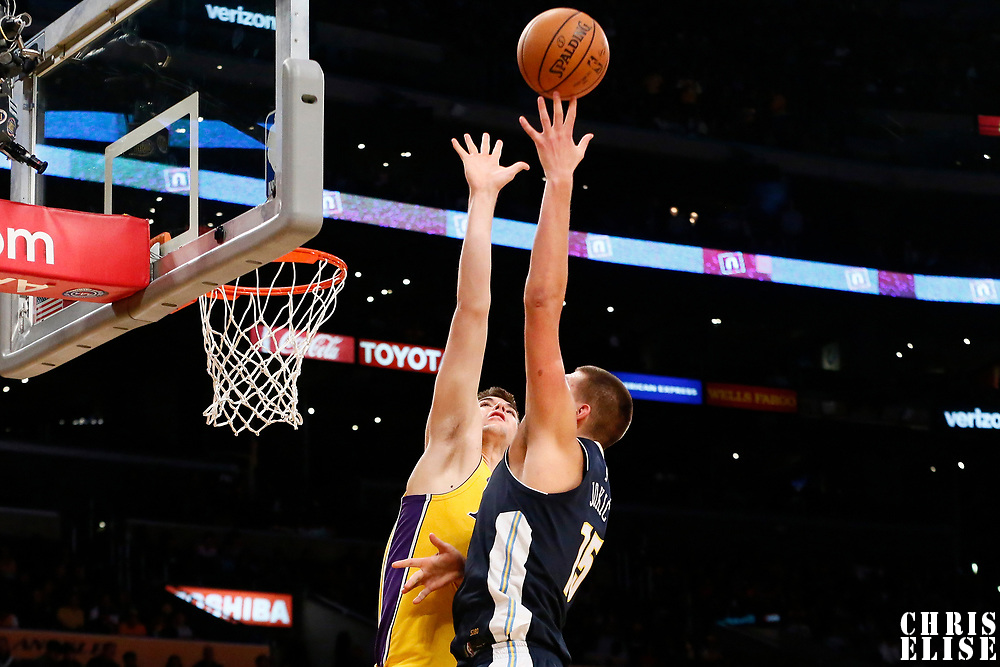 02 October 2017: Denver Nuggets center Nikola Jokic (15) goes for the baby hook over Los Angeles Lakers center Ivica Zubac (40) during the Denver Nuggets 113-107 victory over the LA Lakers, at the Staples Center, Los Angeles, California, USA.