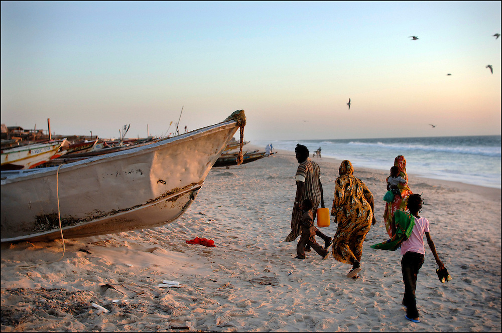 Mauritania October 27, 2006 -Nouakchott Beach at sunset with Mauriatian's people and Fishing Boats ©Jean-Michel Clajot