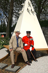 SIR TERENCE CONRAN and a Chelsea pensioner at the 2005 RHS Chelsea Flower Show on 23rd May 2005<br />