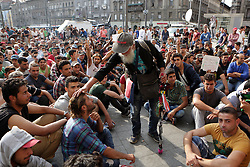 © Licensed to London News Pictures. Refugees, who did not board trains hold a peaceful protest outside Keleti train station in Budapest, Hungary on 3rd of September, 2015 . Earlier in the day groups of migrants where transported to camps unaware of where they were being taken. Photo credit: Gabriel Szabo/LNP