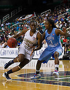 Georgia Tech's Tyaunna Marshall (15) drives to the basket past North Carolina's She'la White (1) during this 2nd round game in the 2012 ACC Women's Basketball Tournament in Greensboro, North Carolina.  Georgia Tech won 54 - 53.  March 02, 2012  (Photo by Mark W. Sutton)