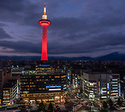 Standing 131 meters tall just across from Kyoto Station in Japan, Kyoto Tower is the city's tallest structure. The tower was completed in 1964, the same year as the opening of the shinkansen (bullet train) and the Tokyo Olympics. A viewing platform is located 100 meters above ground with a 360 degree view of Kyoto, and as far as Osaka on clear days. Kyoto Tower stands on top of a typical commercial building with souvenir shops, restaurants, hotel and public bath in the basement.