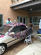 Students at Herod ES decorate their art car for this year's Art Car parade.