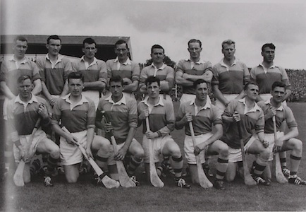 "Wexford-All-Ireland Hurling Champions 1960.. Back Row: Padge Kehoe, Tom Neville, John Nolan, Nick O'Donnell (capt), Tim Flood, Billy Rackard, Ned Wheeler, Jim Morrissey. Front Row: Jim English, John Mitchell, Pat Nolan, Jimmy O'Brien, Jack Harding, Oliver ""Hopper"" McGrath, Seamus Quaid."