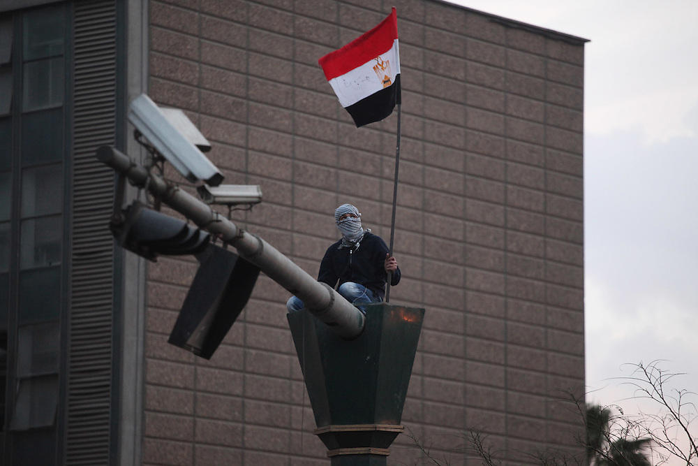 A protester at Cairo's main Tahrir (Liberation) Square waves an Egyptian flag.