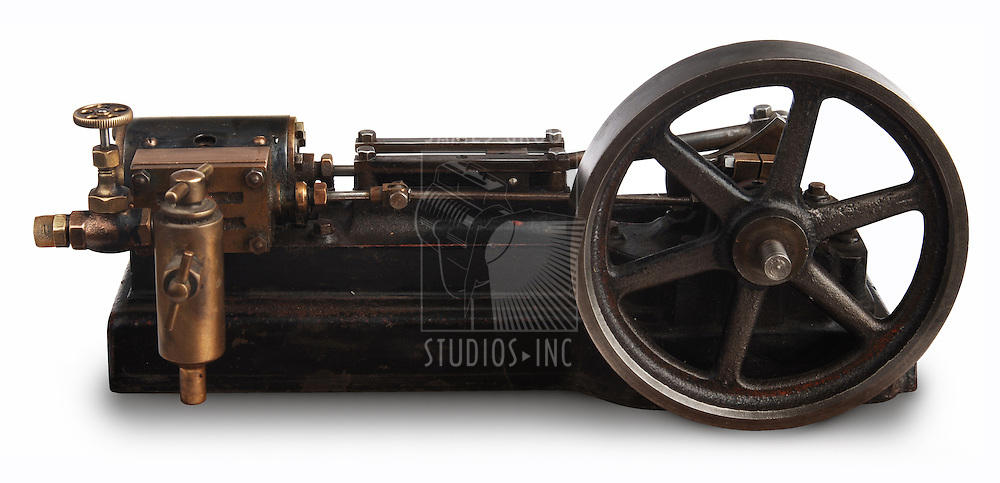 Steam engine piston and flywheel