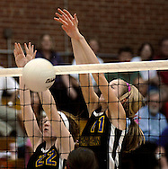 """6 Oct. 2011 -- ST. LOUIS. -- Rosati-Kain High School volleyball players Rose Griffin (22) and Rebecca Lynch (11) block a shot by Bishop DuBourg High School during a special """"pink game"""" between the schools at DuBourg Thursday, Oct. 6, 2011. The """"pink game"""" to benefitted SSM St. Mary's Health Care Center's Cancer Care, in honor of Rosati-Kain president Sister Joan Andert, SSND, who is currently undergoing treatment for breast cancer. Photo © copyright 2011 Sid Hastings."""