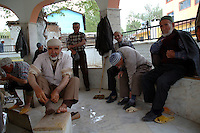 Men washing feet and doing religious ablutions by mosque in town of Gombe in Anatlya turkey.