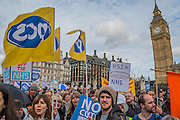 Arriving in Parliament square for speeches - A march against cuts to and potential privatisation of the NHS starts in Tavistock Square and heads for Parliament Square. The march was organised by the peoples assembly and supported by most major unions and the Labour Party. London  04 Mar 2017