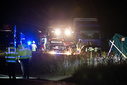 © Licensed to London News Pictures . 21/07/2014 . Nottinghamshire , UK . Police , fire crew and ambulances on the A1 road in Ranby yesterday morning (21st July 2014) following a fatal multi vehicle accident . Leroy and Sheila Carrington (aged 68 and 58) died at the scene when the Peugot 206 they were driving collided with a Vauxhall Astra . Roderick Franks (58) , who was a passenger in the Astra , died in hospital , following the crash . The road was closed in both directions whilst police investigated the scene .  Photo credit : Joel Goodman/LNP