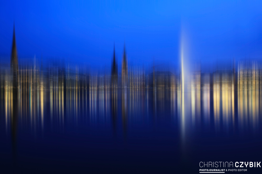 Blurry Sky Fine Art Series - Skyline at the Binnenalster with Rathaus, Alsterhaus and St. Nikolai Mahnmal in Hamburg