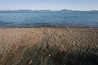 ANGUILLARA SABAZIA (LAKE BRACCIANO), ITALY - 26 JULY 2017: A view of Lake Bracciano whose level has dropped more than 1,50 meters recently, inAnguillara Sabazia (Lake Bracciano), Italy, on July 26th 2017.<br /> <br /> Lake Bracciano provides eight percent of Rome's water and has sunk about 1.5 meters<br /> <br /> A severe drought and sweltering temperatures have led Rome city officials to consider a potential rationing of drinking water for eight hours a day for a million and a half Rome residents. The water crisis has become yet another sign of man being at the mercy of an increasingly extreme climate, but also of once mighty Rome's political impotence, managerial ineptitude and overall decline.