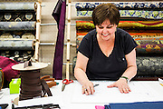 DEXTER, ME - AUGUST 4, 2015:  Sue Nordman, owner of Erda Handbags, works on the pattern for a new line of mens shaving kits at the company's production facility in Dexter, Maine. Since most of Erda's employees are 60 years or older they have implemented a flexible scheduling system and invested in more ergonomic machines to accommodate their aging workforce. <br /> Craig Dilger for The New York Times