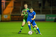 Canice Carroll (#4) of Carlisle United FC shields the ball from Carl Winchester (#7) of Forest Green Rovers during the The FA Cup match between Carlisle United and Forest Green Rovers at Brunton Park, Carlisle, England on 10 December 2019.