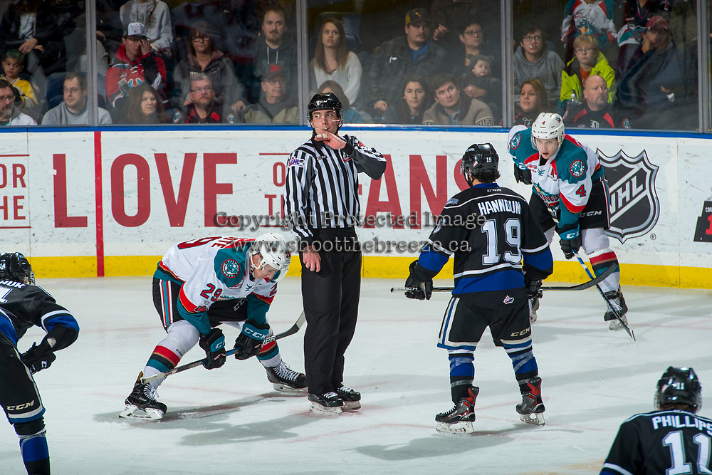 KELOWNA, CANADA - DECEMBER 30: Linesman Tim Plamondon blows the whistle at the face off between Nolan Foote #29 of the Kelowna Rockets and Dante Hannoun #19 of the Victoria Royals on December 30, 2017 at Prospera Place in Kelowna, British Columbia, Canada.  (Photo by Marissa Baecker/Shoot the Breeze)  *** Local Caption ***
