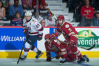 REGINA, SK - MAY 27: Justin Ducharme #71 and Samuel Asselin #28 of Acadie-Bathurst Titan check Sam Steel #23 of Regina Pats during first period at the Brandt Centre on May 27, 2018 in Regina, Canada. (Photo by Marissa Baecker/CHL Images)