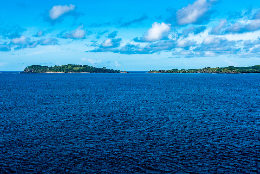 Blue waters of the Pacific Ocean with the Fiji island of Lautoka in the background.