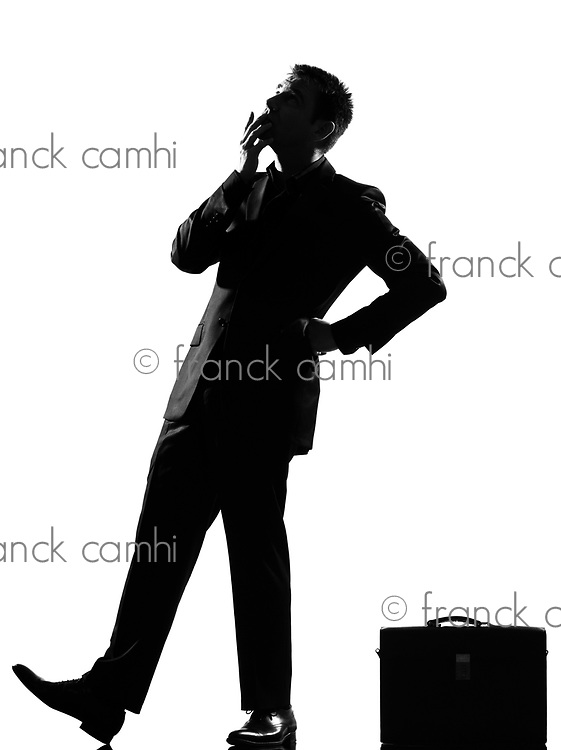 silhouette caucasian business man thinking pensive behavior  looiking up full length on studio isolated white background