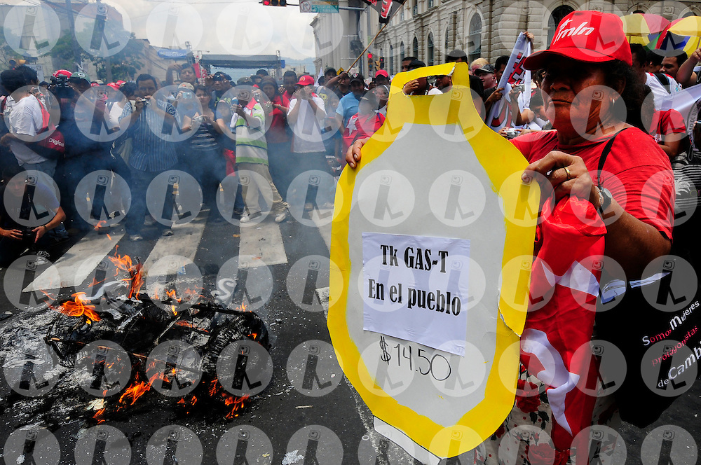 People take part in International Workers' Day, or Labour Day, celebrations in San Salvador May 1, 2011. Thousands of people at the celebrations also protested against the high cost of living and demanded a pay rise from the government. Photo Wilton Castillo