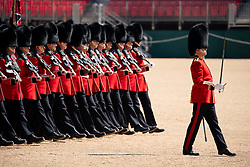 © Licensed to London News Pictures. 13/05/2019. London, UK. Soldiers from the Queen's Guard take part in a rehearsal of 'Trooping the Colour' at Horse Guards Parade. The ceremony celebrates the official birthday of the Queen, and takes place this year on Saturday, 8 June 2019. Photo credit : Tom Nicholson/LNP