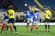 Oxford United defender Johnny Mullins gets in a header during the Sky Bet League 2 match between Oxford United and Carlisle United at the Kassam Stadium, Oxford, England on 12 December 2015. Photo by Alan Franklin.