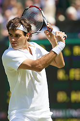 LONDON, ENGLAND - Monday, June 23, 2008: Roger Federer (SUI) in action during his first round match on day one of the Wimbledon Lawn Tennis Championships at the All England Lawn Tennis and Croquet Club. (Photo by David Rawcliffe/Propaganda)