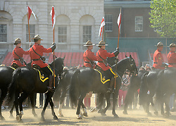 © Licensed to London News Pictures. 23/05/2012. London, UK The horse kick up the dust on HOrse Guards. Canadian Mounties Guard Her Majesty the Queen at Horse Guards Parade on Whitehall in Westminster. They will guard on all day and will be the first non-British force to guard the Queen. Photo credit : Stephen Simpson/LNP