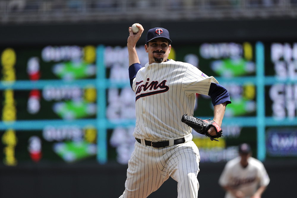 MINNEAPOLIS - APRIL 24:  Carl Pavano #48 of the Minnesota Twins pitches against the Cleveland Indians on April 24, 2011 at Target Field in Minneapolis, Minnesota.  The Twins defeated the Indians 4-3.  (Photo by Ron Vesely)  Subject:  Carl Pavano