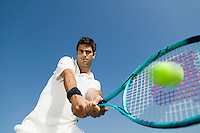 Male Tennis Player Hitting Ball low angle view close up of racket