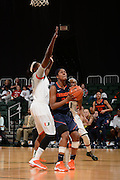 February 20, 2014: Tiara Butler #32 of Syracuse shoots over Keyona Hayes #20 of Miami during the NCAA basketball game between the Miami Hurricanes and the Syracuse Orange at the Bank United Center in Coral Gables, FL. The Orange defeated the Hurricanes 69-48.