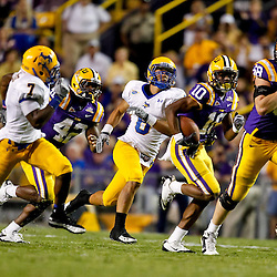 October 16, 2010; Baton Rouge, LA, USA; LSU Tigers wide receiver Russell Shepard (10) runs with the ball against the McNeese State Cowboys during a game at Tiger Stadium. LSU defeated McNeese State 32-10. Mandatory Credit: Derick E. Hingle