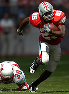 MORNING JOURNAL/DAVID RICHARD<br />Ohio State tailback Antonio Pittman breaks a tackle yesterday in the second quarter.