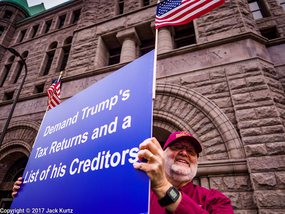 29 APRIL 2017 - MINNEAPOLIS, MINNESOTA: A man carries a sign calling for the release of President Donald Trump's taxes during the People's Climate Solidarity March in Minneapolis. Thousands of people marched through downtown Minneapolis and rallied around the US Federal Courthouse to participate in the People's Climate Solidarity March. The Minneapolis march coincided with other marches to protest the climate change policies of President Trump and the Republican Party that were held across the US. It took place just one week after a series of large marches in support science and fact based decision making.     PHOTO BY JACK KURTZ